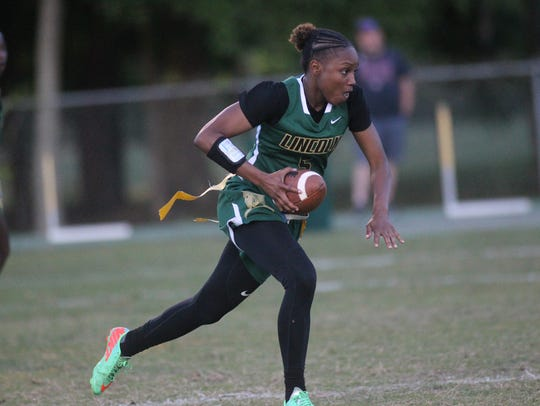 Lincoln's Charisse Thomas runs the ball against Florida