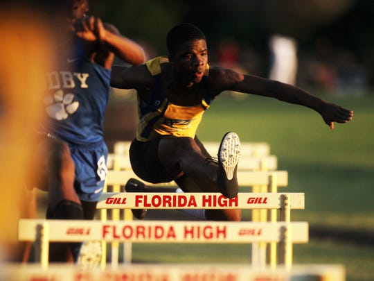 Rickards' Jabari Bryant clears a hurdle on the way to a win in the 300-meter hurdles during Wednesday's Region 1-2A meet at Florida High.