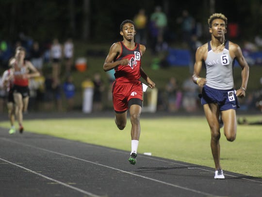 North Florida Christian's David Keen races in the finish