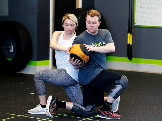 Courtney Tarmann and Nathan Kowalczyk demonstrate the