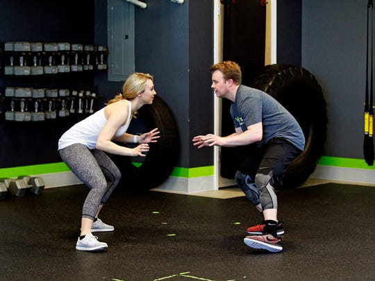 Courtney Tarmann and Nathan Kowalczyk demonstrate the  partner mirror drill exercise at bodyfuel inc.