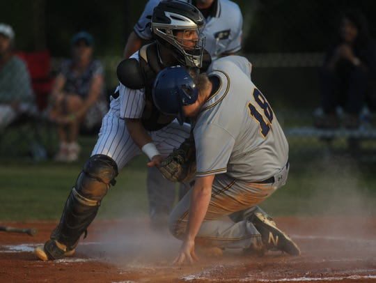 St. John Paul II's Jared Findlay slides into home plate
