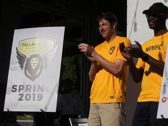 Noah Roberts and Kenny Nwoko celebrate the logo reveal