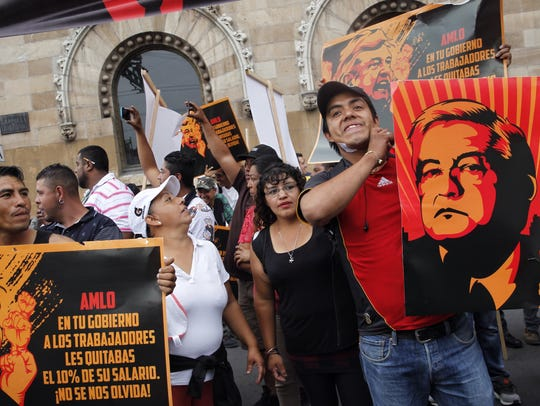 Supporters of presidential candidate Ricardo Anaya protest against leftist candidate Andres Manuel Lopez Obrador before the start of the first presidential debate in Mexico City on April 22, 2018.