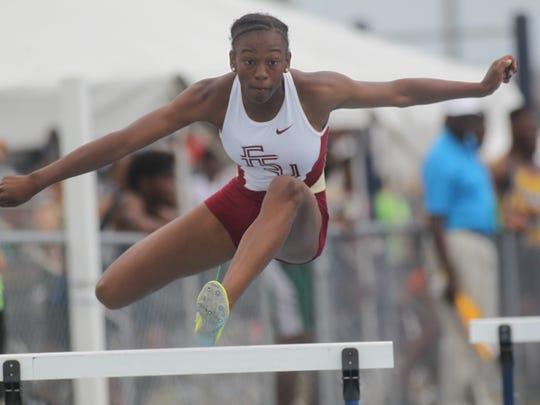 Florida High eighth-grader Tonie Morgan clears a hurdle