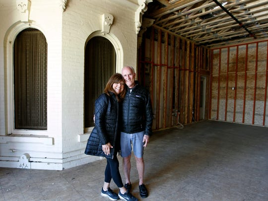 Pam and Mike Buckley, the founders of Buckley's Restaurant & Bar, stand on the second floor in the new connector building. The corner building's two-story bay windows were preserved and will be visible in upper and lower dining rooms.