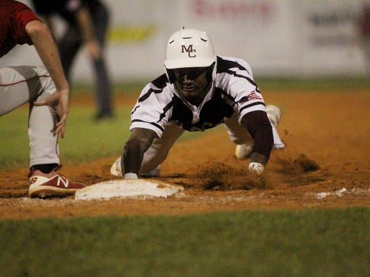 Madison County's Tre Adams dives back into first base