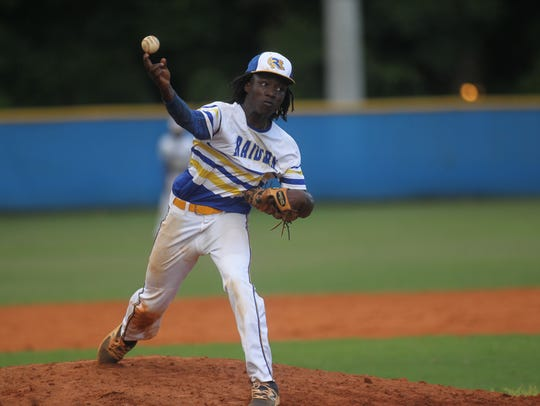 Rickards' Ferante Cowart pitches during a Region 1-5A