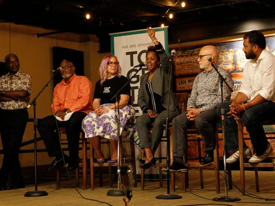 "(From left) Andre Lee Ellis,  Earl Ingram Jr., Nicole ""Darlin Nikki"" Janzen, Tina Nixon, Gary Hollander and Pardeep Singh Kaleka appear at the Anodyne Cafe in Walker's Point for a Journal Sentinel storytellers event focused on racism in Milwaukee."