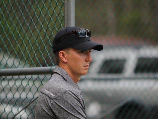 Chiles tennis coach Owen Long watches his team. Long