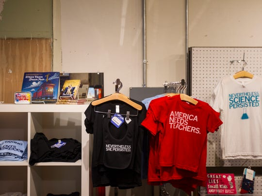 Shirts are displayed inside Raygun's College Street