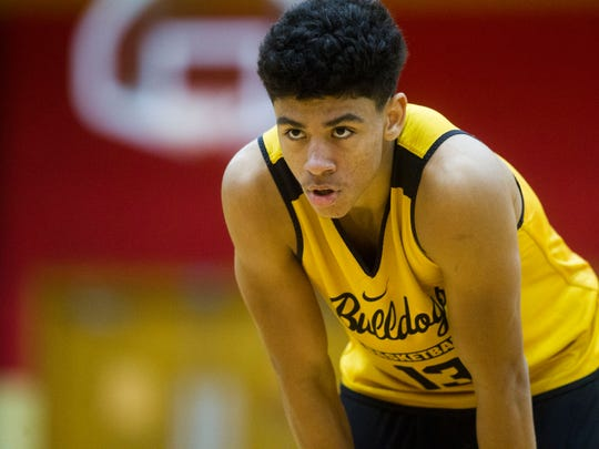 Bettendorf point guard D.J. Carton catches his breath