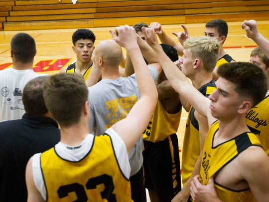 Bettendorf point guard D.J. Carton (top left) huddles with teammates before a basketball game against Rock Island in the Justin Sharp Memorial Shootout at Rock Island High School on Friday, June 22, 2018 in Rock Island, Illinois. Carton is entering his senior year at Bettendorf.