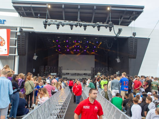 Concertgoers mingle at the new U.S. Cellular Connection Stage on the Summerfest grounds before a stage-warming concert featuring Diplo on Friday.