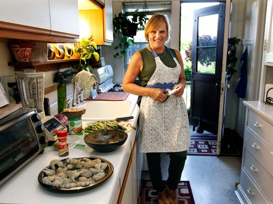 Milwaukeean Vicki Brown finds empowerment in cooking for herself at home; Here, she's ready to prepare a favorite shrimp and bean dish.