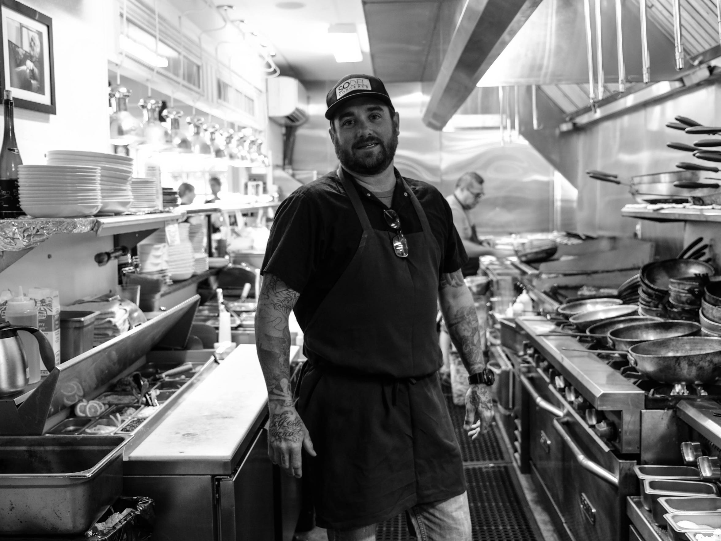 Jason Dietterick, executive chef at Bluecoast in Rehoboth Beach, stands in the kitchen during a busy lunch. He says he could relate Anthony Bourdain's struggles with depression and past substance abuse.