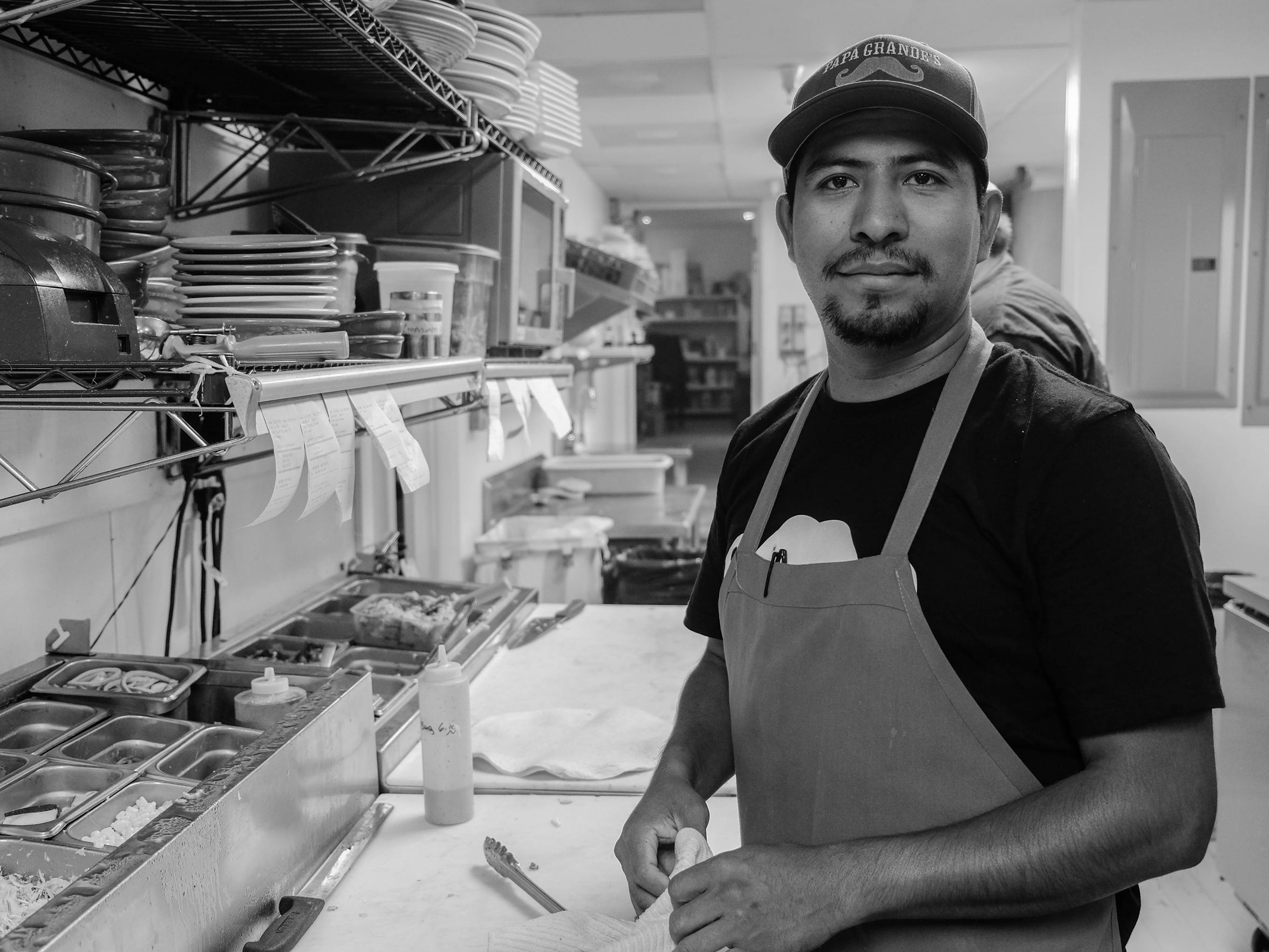 "Efrain Martinez, executive chef at Papa Grande's Taqueria, pauses from busting out orders. ""I started from the bottom, washing dishes, prepping,"" he said. ""And now I'm working for SoDel Concepts."""