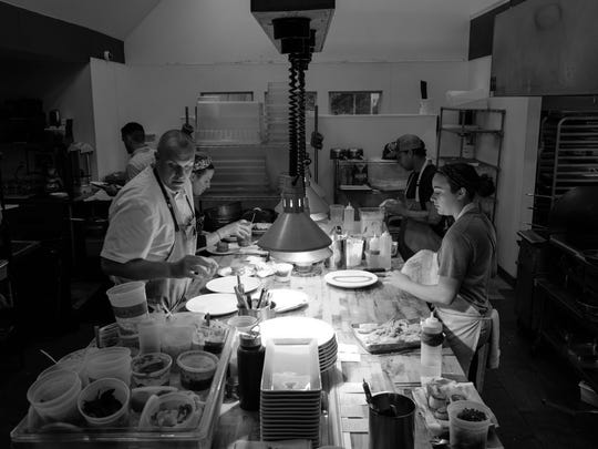 The kitchen at Heirloom in Lewes is in full force during dinner service.