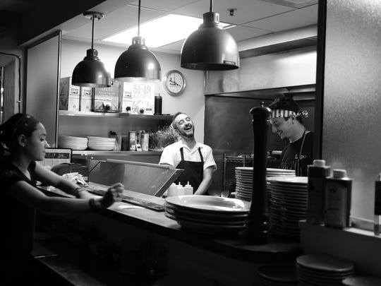 Chris Parks, executive chef at Lupo Italian Kitchen in Rehoboth Beach, takes a breather after dinner rush.