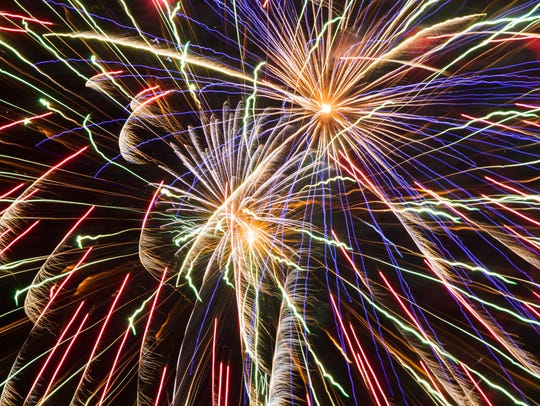 Fireworks explode during 4th Fest in Coralville on