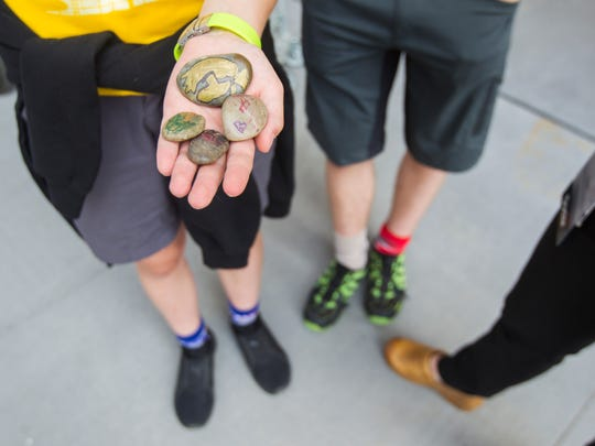 Morgan Shelton, 14, of Iowa City, holds out rocks that