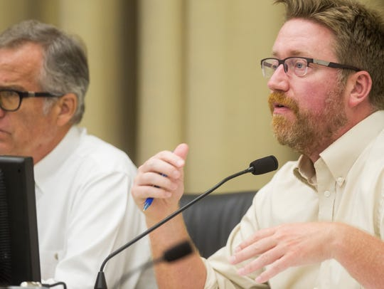 City Councilor Rockne Cole (right) is seen on Tuesday,