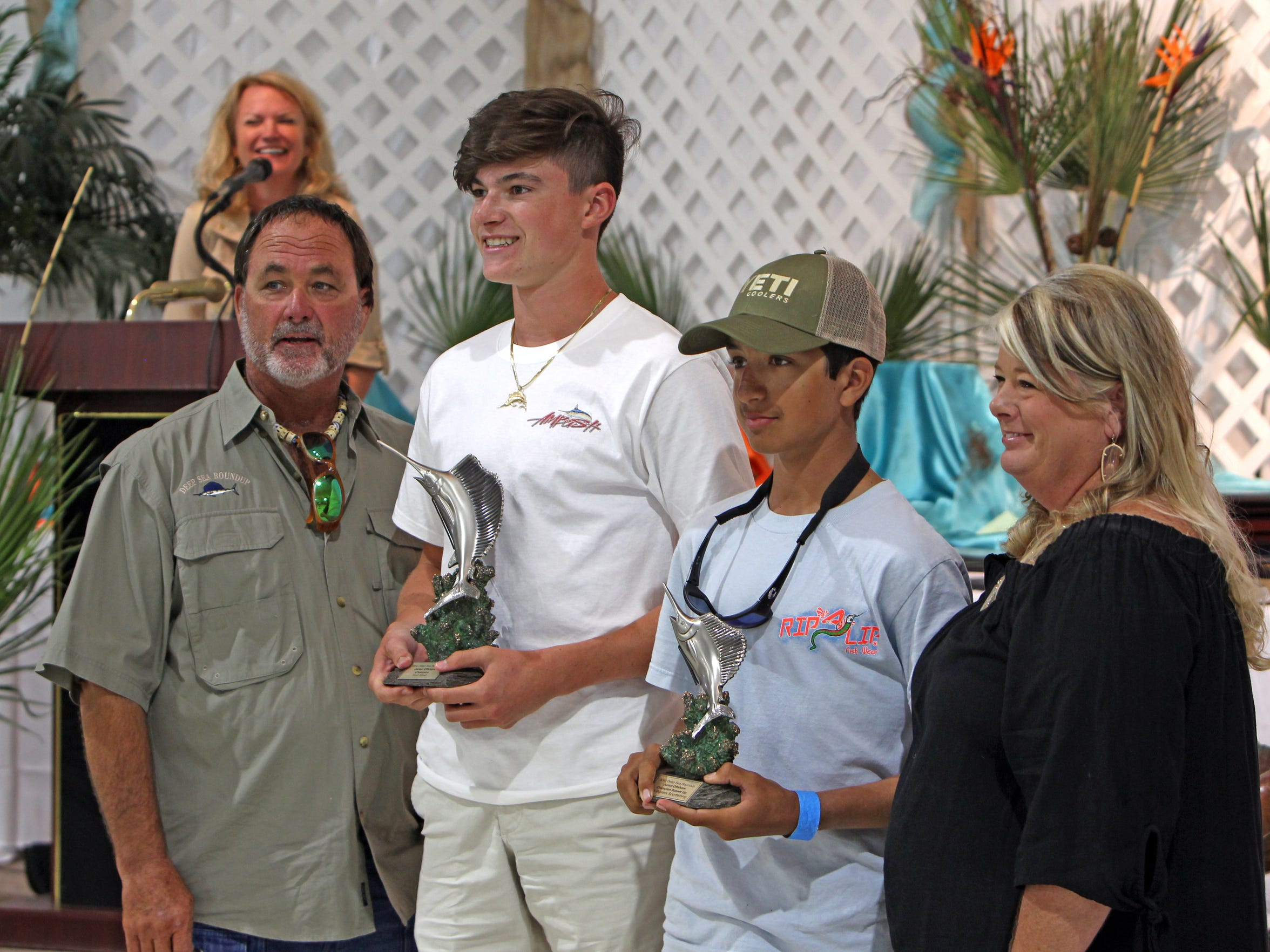 The 83rd Deep Sea Roundup Junior Offshore Grand Champion is Mason Furlow, on left with trophy, and runner-up is Cooper Alvarez.