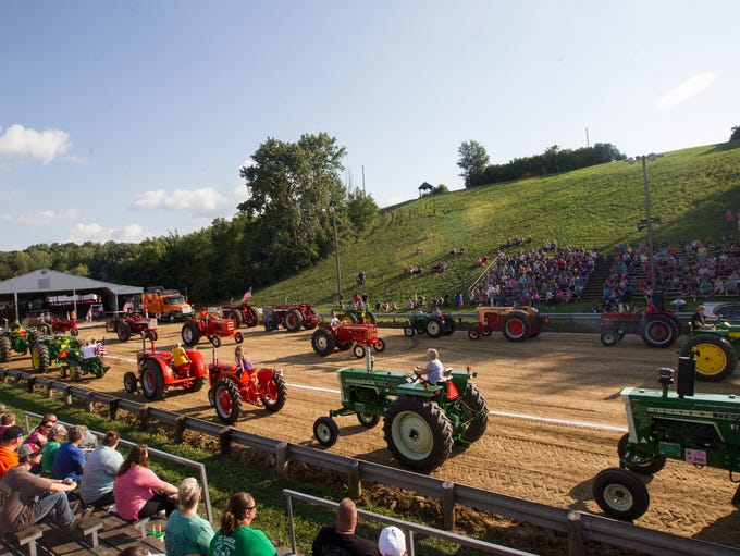 Tractors are introduced during a Johnson County Agricultural