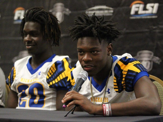 Rickards running back Kelvin Dean speaks during 2018