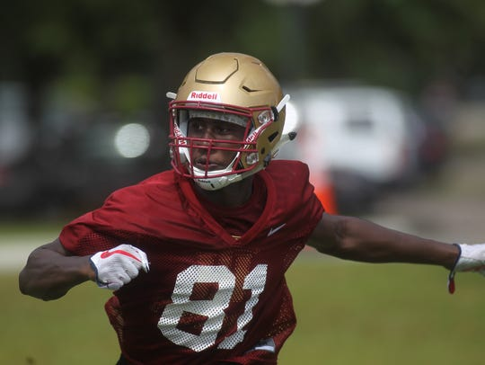 Cornerback Raymond Woodie Jr. and Florida High's football