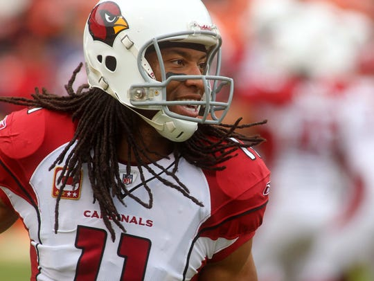 Larry Fitzgerald warms up before a game against the 49ers at Candlestick Park on Jan. 2, 2011.