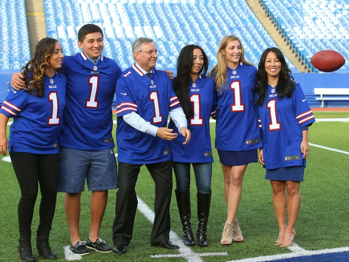 Terry Pegula, center, new owner of the Buffalo Bills,