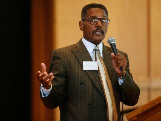 """Almer """"Al"""" Jackson speaks about his plans to turn the Central Bible College campus into an education and treatment center for military veterans. TOP: Jackson speaks about his plans during his presentation to a roomful of almost 100 people."""