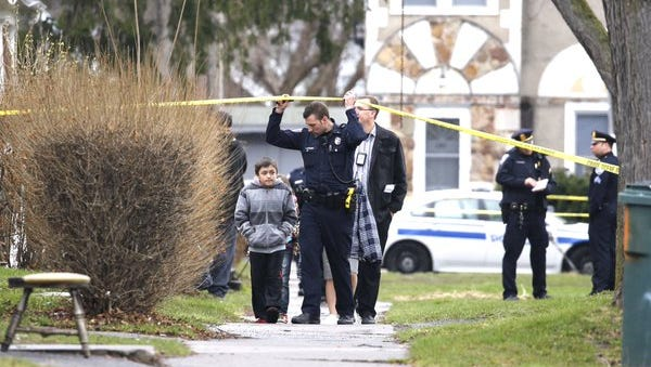 Police investigate a shooting on Wilder Street.