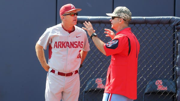 Coach Mike Bianco (right) speaks with Dave Van Horn during their series over the weekend.