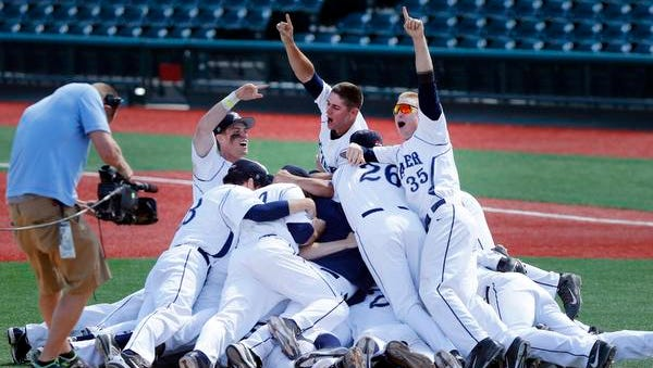 Xavier players celebrate after winning the Big East Championship against Creighton on Sunday.