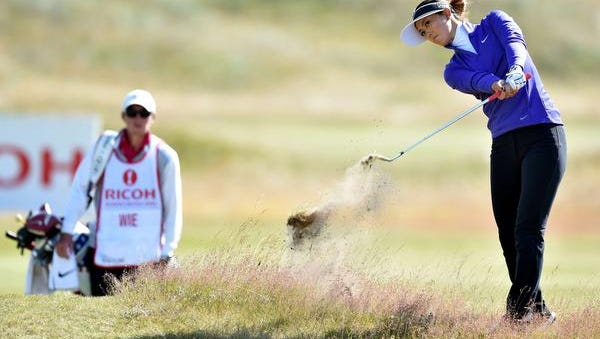 Michelle Wie plays out of the rough onto the 11th green at Royal Birkdale during the Women's British Open on Thursday.