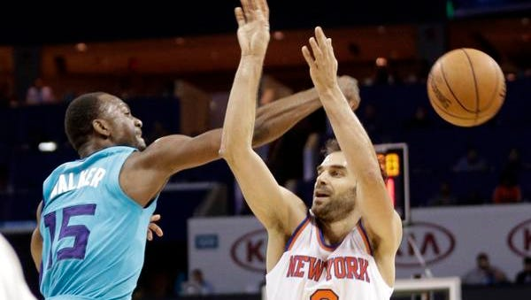 Charlotte Hornets' Kemba Walker (15) blocks a shot by New York Knicks' Jose Calderon (3) during the second half of an NBA basketball game in Charlotte, N.C., Friday, Dec. 5, 2014. The Hornets won 103-102.