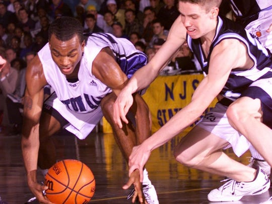 Seton Hall Prep's Mark Curry and CBA's Tim Begley chase a loose ball during the 2000 NJSIAA Parochial A championship game at the Dunn Center in Elizabeth.
