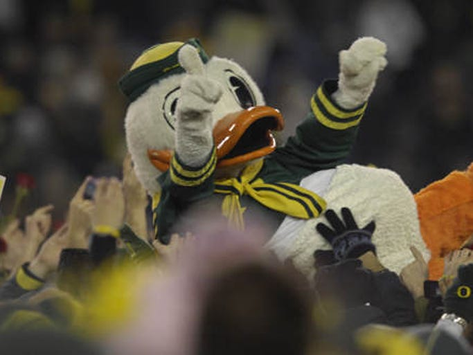 The Oregon Duck crowd surfs at the Oregon vs. Oregon State football game at Autzen Stadium in Eugene on Thursday, Dec. 3, 2009. Oregon defeated Oregon State 37-33.