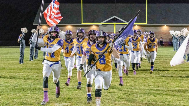 Hallsvile seniors Cooper Crane (17) and Andrew Huddleston (8) lead the Indians onto the field before their game with Tolton in 2019. Hallsville is going into this upcoming season with a younger squad and more uncertainties, but head coach Justin Conyers feels his team is up to the challenge. Hallsville is set to face Tolton in this year's season opener.