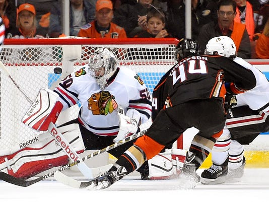 Nate Thompson, Corey Crawford, Duncan Keith