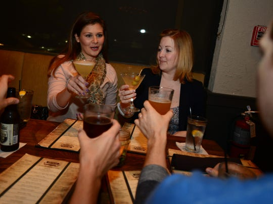 Ryan Harkins, left, Liz Harkins, second from left, Eleanor Vaughn, second from right, and Cameron Vaughn, right, have dinner at Southern Culture Kitchen and Bar on Tuesday, October 15, 2014.