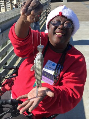 Wanda Ruth of Elmira, shown here with a black sea bass, won a recent national fishing tournament in North Carolina for people with visual impairment.