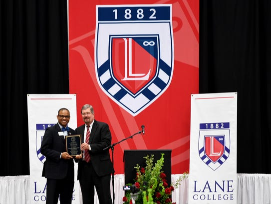 Lane College President Dr. Logan Hampton receives a