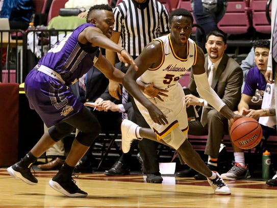 Midwestern State's Logan Hicks drives to the basket