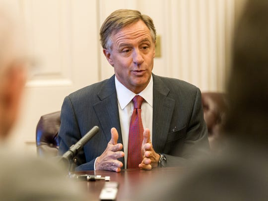 Republican Gob. Bill Haslam speaks to reporters at