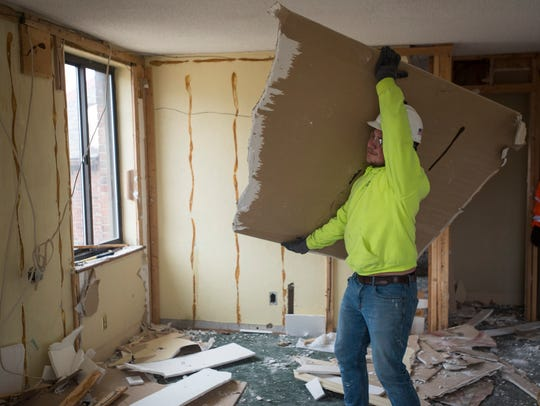 Westhaven Builders LCC employee Chad Brennan lifts