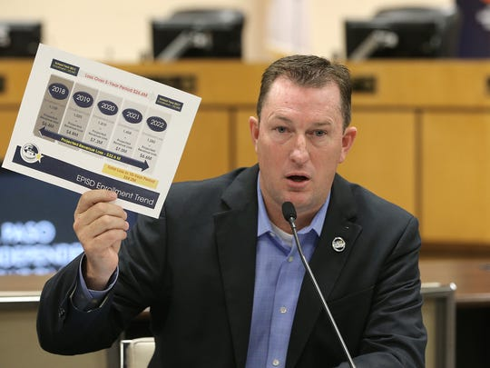 El Paso Independent School District board President Trent Hatch shows the district's budget shortfall of almost $7 million for the 2018 school year, which he says is from declining enrollment. The district is now considering closing 10 elementary schools to help make up for the deficit.