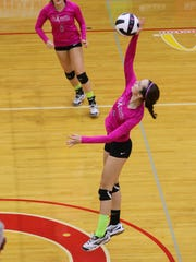 Palmetto senior middle hitter Leah Barnhardt makes the winning kill against Walhalla during the fourth set in Williamston.